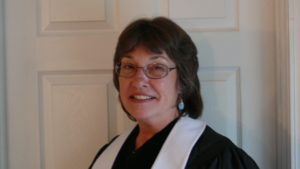 headshot-style photo of Jamie Throneberry in her officiant robes
